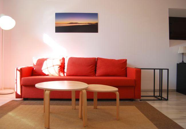 Salón con sofá cama doble, aire acondicionado y calefacción